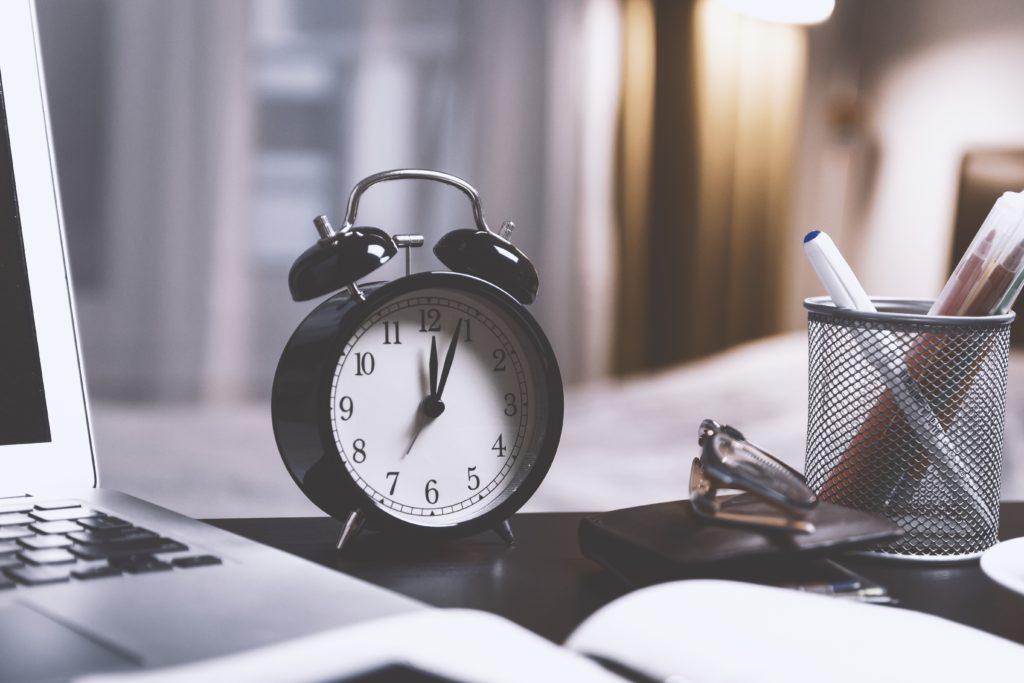 Time Management For Artists - Alarm Clock on a desk