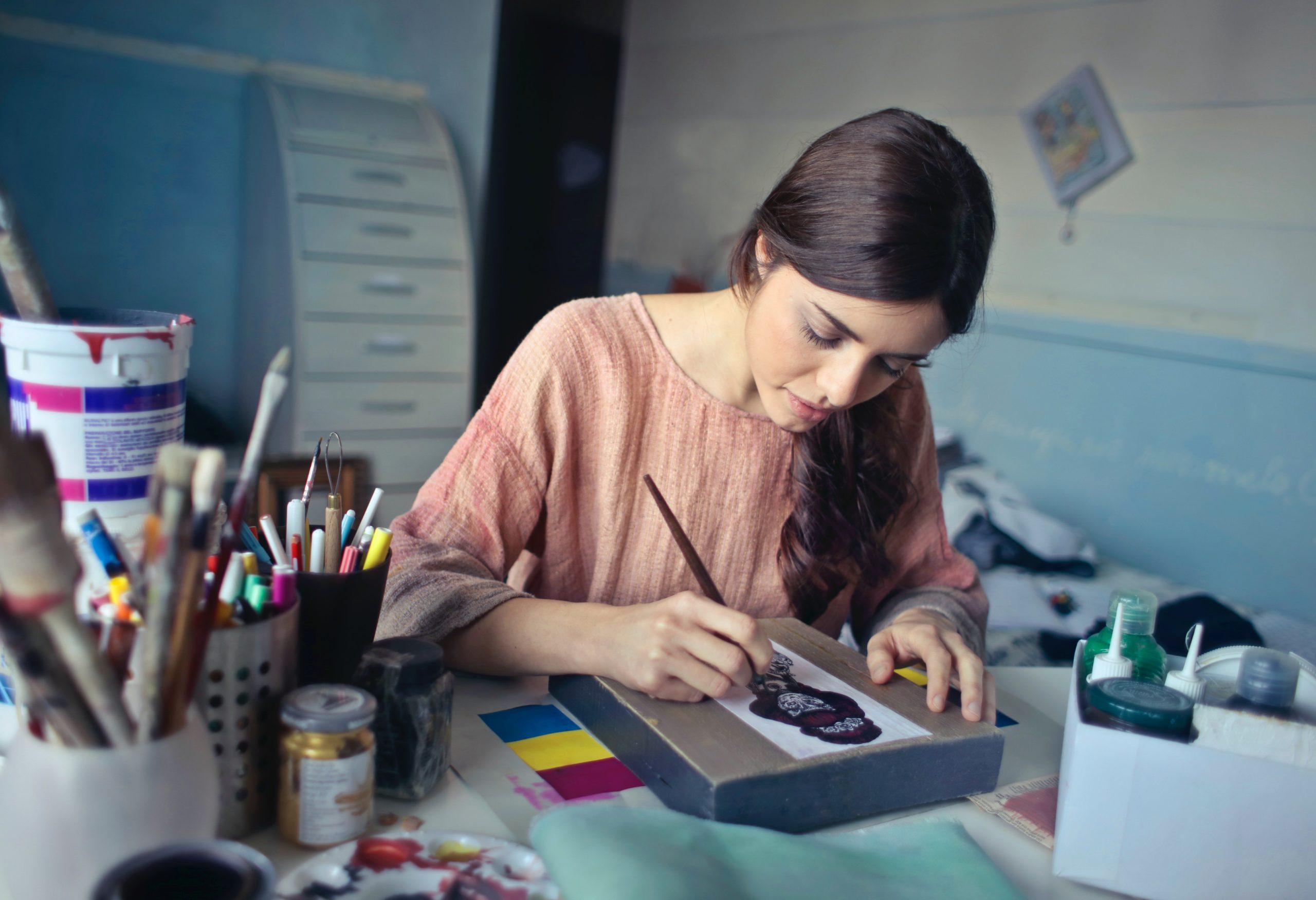 Woman writing her artist statement